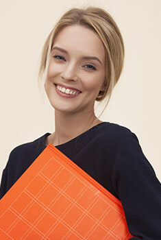 woman smiling with orange binder