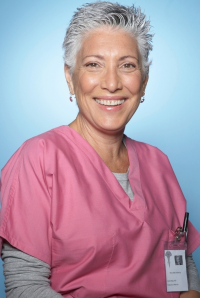 female medical assistant in pink scrubs