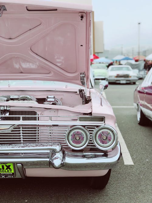 Pink car with the hood up